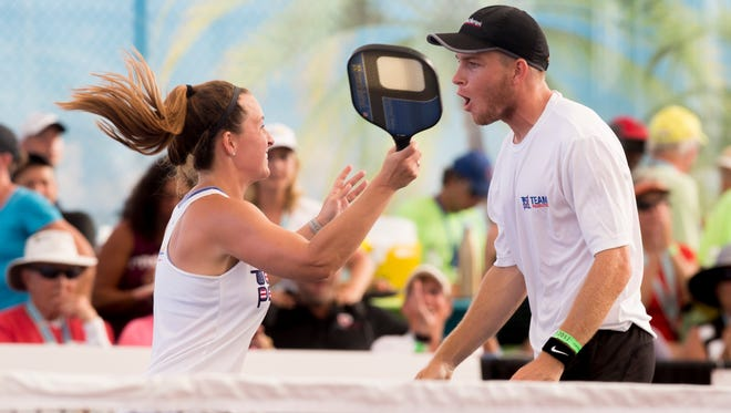 Kyle and Sarah Yates celebrate after defeating Christine McGrath and Rafael Siebenschein to take hoe the gold medal during the U.S. Open Pickleball 19-and-over mixed doubles championship match at East Naples Community Park Tuesday, April 25, 2017.