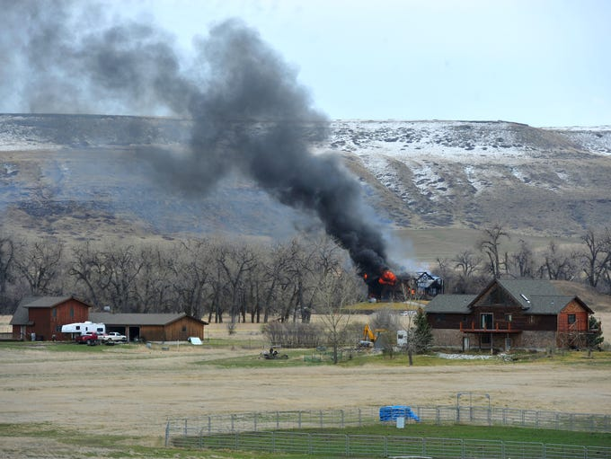 The house at 55 Tumbleweed Lane burns on Monday afternoon.