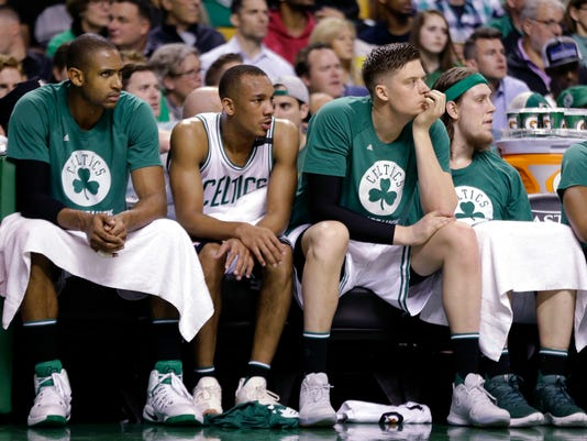 Boston Celtics, from left, Al Horford, Avery Bradley, Jonas Jerebko and Kelly Olynyk watch from the bench during the second half of Game 5 of the NBA basketball Eastern Conference finals against the Cleveland Cavaliers, on Thursday, May 25, 2017, in Boston. (AP Photo/Elise Amendola)