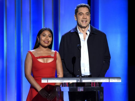 Yalitza Aparicio, left, and Javier Bardem present the award for best female lead at the 34th Film Independent Spirit Awards.