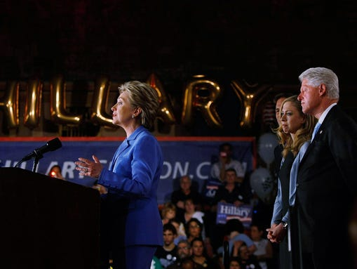 Hillary Clinton addresses the crowd as Bill Clinton