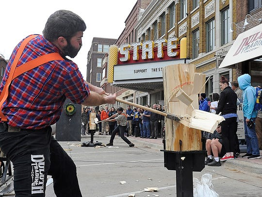 Professional lumberjacks put on a show at the opening of a Duluth Trading Company store in South Dakota in 2015.