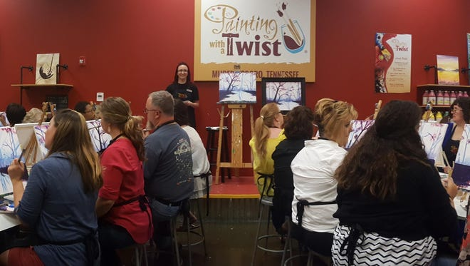 A class underway at the Painting with a Twist entertainment studio at The Avenue Murfreesboro shopping center.
