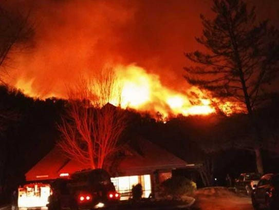 Flames move along Webb Mountain above Bent Creek Resort in Pittman Center during the Nov. 28, 2016, wildfire.