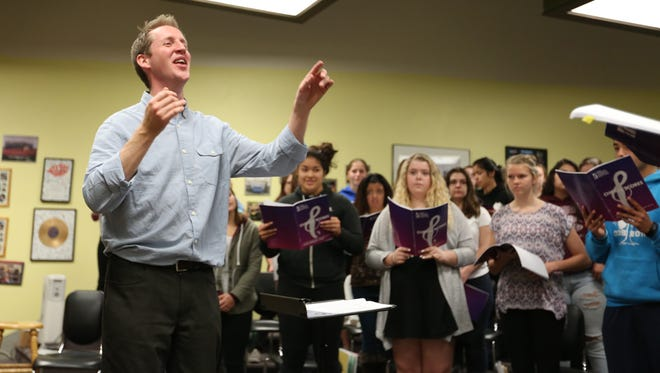 Justin Doyle, a visiting conductor from London, works with students during a choir class Wednesday, Nov. 4, 2015, at Stayton High School.