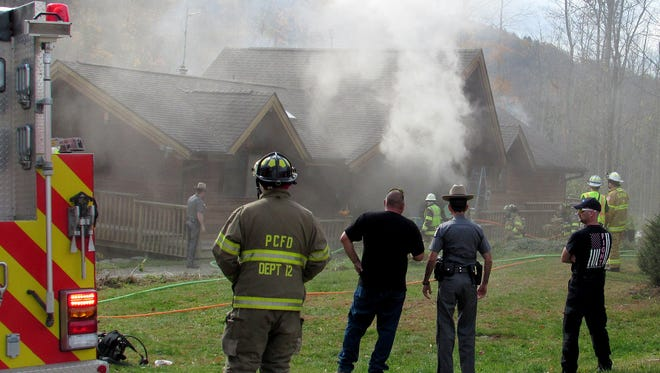 Volunteer firefighters battle a smoky house fire on Sagetown Road in the Town of Caton.