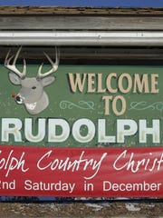 A sign welcome motorists to town in Rudolph. Postmaster Becky Trzebiatowski says the town's post office gets tens of thousands of pieces of mail from all over the world every year.
