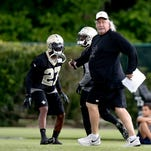 New Orleans Saints defensive coordinator Rob Ryan works with defensive back Champ Bailey (27) during minicamp at the New Orleans Saints Training Facility.