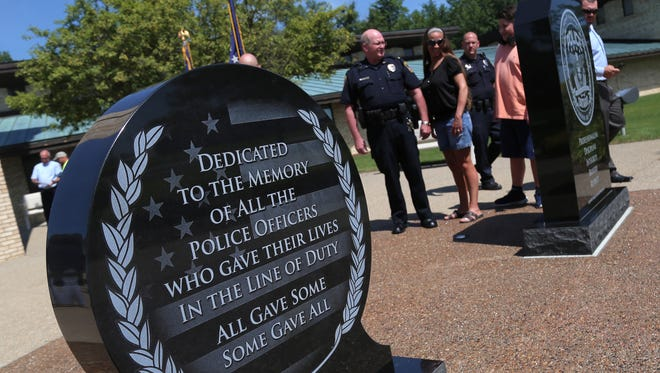 Two granite stones with inscription mark the law enforcement memorial outside of the Ontario City Hall on Wednesday. The memorial was dedicated on Wednesday by various local government officials.