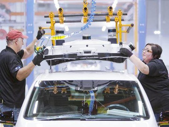 Line workers at General Motors Co.'s Lake Orion plant