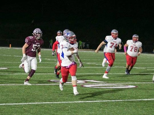 Junior Elan Littrell sprints up the sidelines in the Patriots win over the Warhorses.