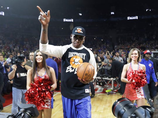 Former Pistons forward Dennis Rodman delivers the game ball for the game against the Wizards, April 10, 2017 in Auburn Hills. This was the last Pistons game at the Palace.