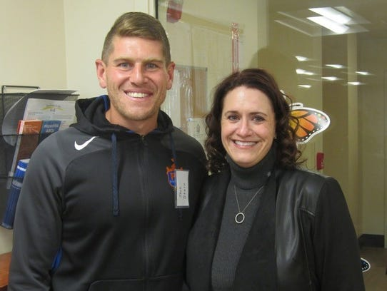 Laurie Nelson (right), CEO of the Center for Respite Care, and Jack Stern, goalkeeper coach for FC Cincinnati.