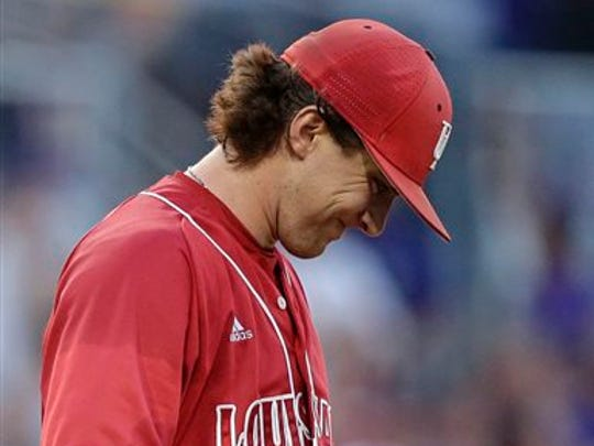 Locks flow out of the cap on UL pitcher Wyatt Marks (31), who is shown here grimacing after giving up a two-run homer by LSU's Jake Fraley during the third inning of a game at the 2015 Baton Rouge Super Regional.