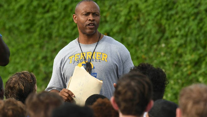 Titusville football head coach Wayne Lawrence talks with his players at the end of practice Wednesday afternoon.
