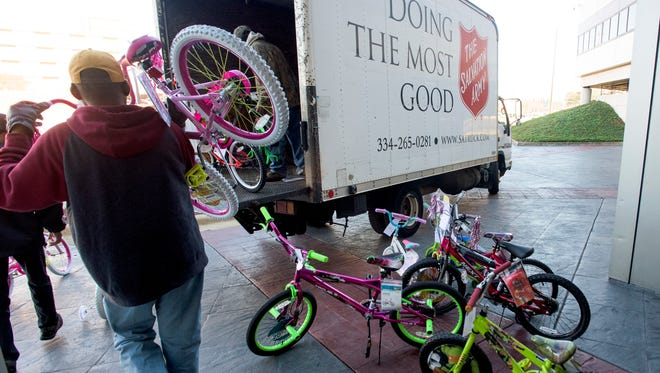 Alfa employees give hundreds of gifts to area needy through the Salvation Army Angel Tree program at the Alfa headquarters in Montgomery, Ala. on Friday December 4, 2015.
