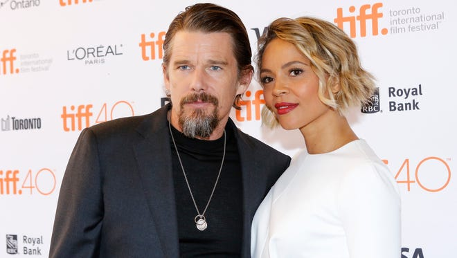 """Ethan Hawke, left, and Carmen Ejogo attend a premiere for """"Born to be Blue"""" on day 4 of the Toronto International Film Festival at the Winter Garden Theatre last September."""