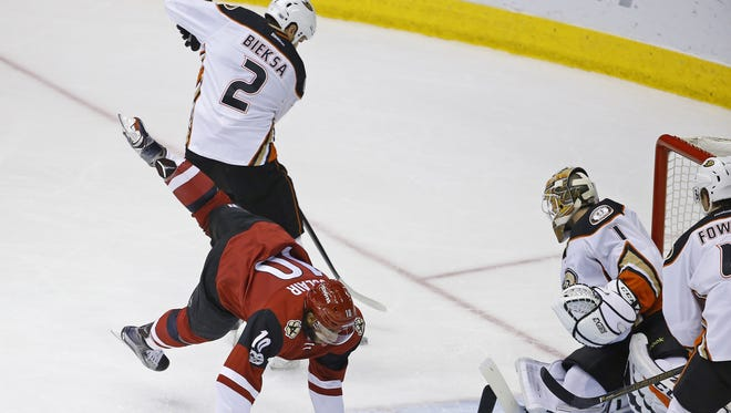 Anaheim Ducks defenseman Kevin Bieksa (2) trips up Arizona Coyotes left wing Anthony Duclair (10) in front of the Ducks goal during the first period of their NHL game Saturday, Jan. 14, 2017 in Glendale, Arizona.