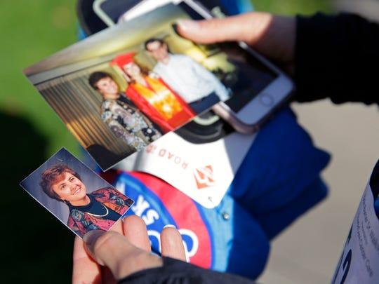 Karen Dietzler holds photos her mother, Ruth Van Asten,