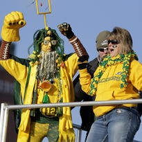 """Brett Steele, 10, of Pittsburgh, PA is fired up dressed as """"Nasty Wedge"""" while tailgating with his father Rick Steele. The Green Bay Packers hostrf the Minnesota Vikings Sunday, January 3, 2016, at Lambeau Field in Green Bay, Wis."""