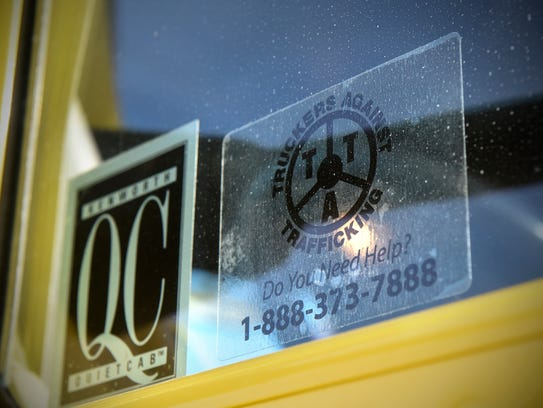 A sticker is affixed to the window of a Brenny Transportation