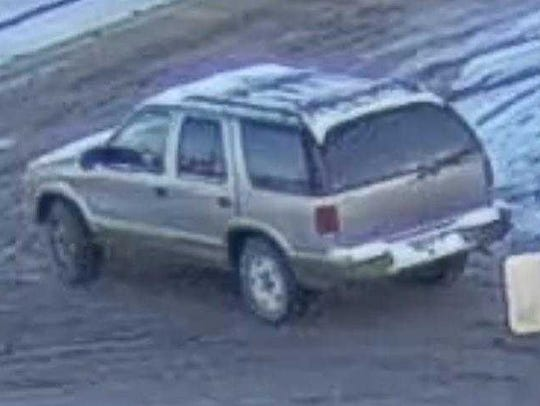 Milwaukee police released a photo of a tan SUV driven