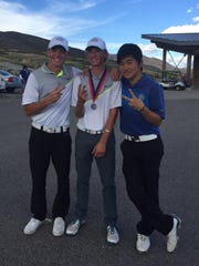 Snow Canyon's Triston Gardner, Brodey Payzant and Dixie's Kosuke Aoki pose for a picture at the end of the 3A state tournament at Soldier Hollow on Thursday.
