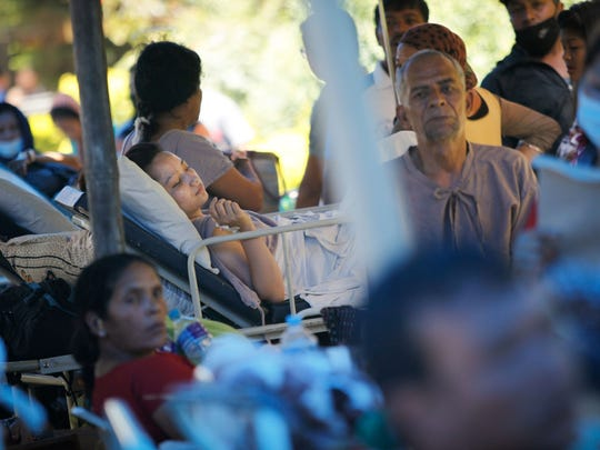 Patients are treated on the outside of the Tribhuvan University Teaching Hospital in Kathmandu the day after a 7.3-magnitude earthquake shook Nepal. The quake was the second major quake in under three weeks.