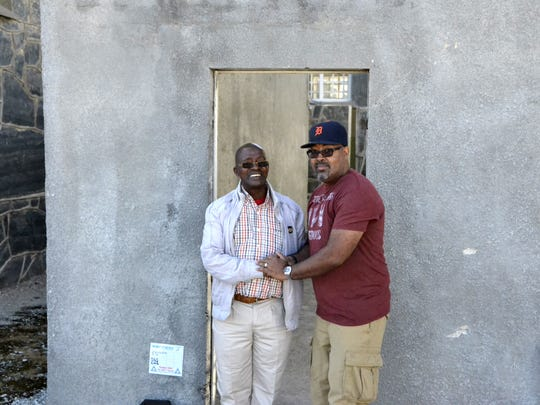 In October of 2014, Eric Hill, right, from Lathrup Village took the D to Robben Island prison, off the coast of Capetown, South Africa, where Nelson Mandela was incarcerated.  He is photographed with  Billy Nair, who was sentenced to 20 years on Robben Island for political crimes also known as sabotage in the eyes of the government.