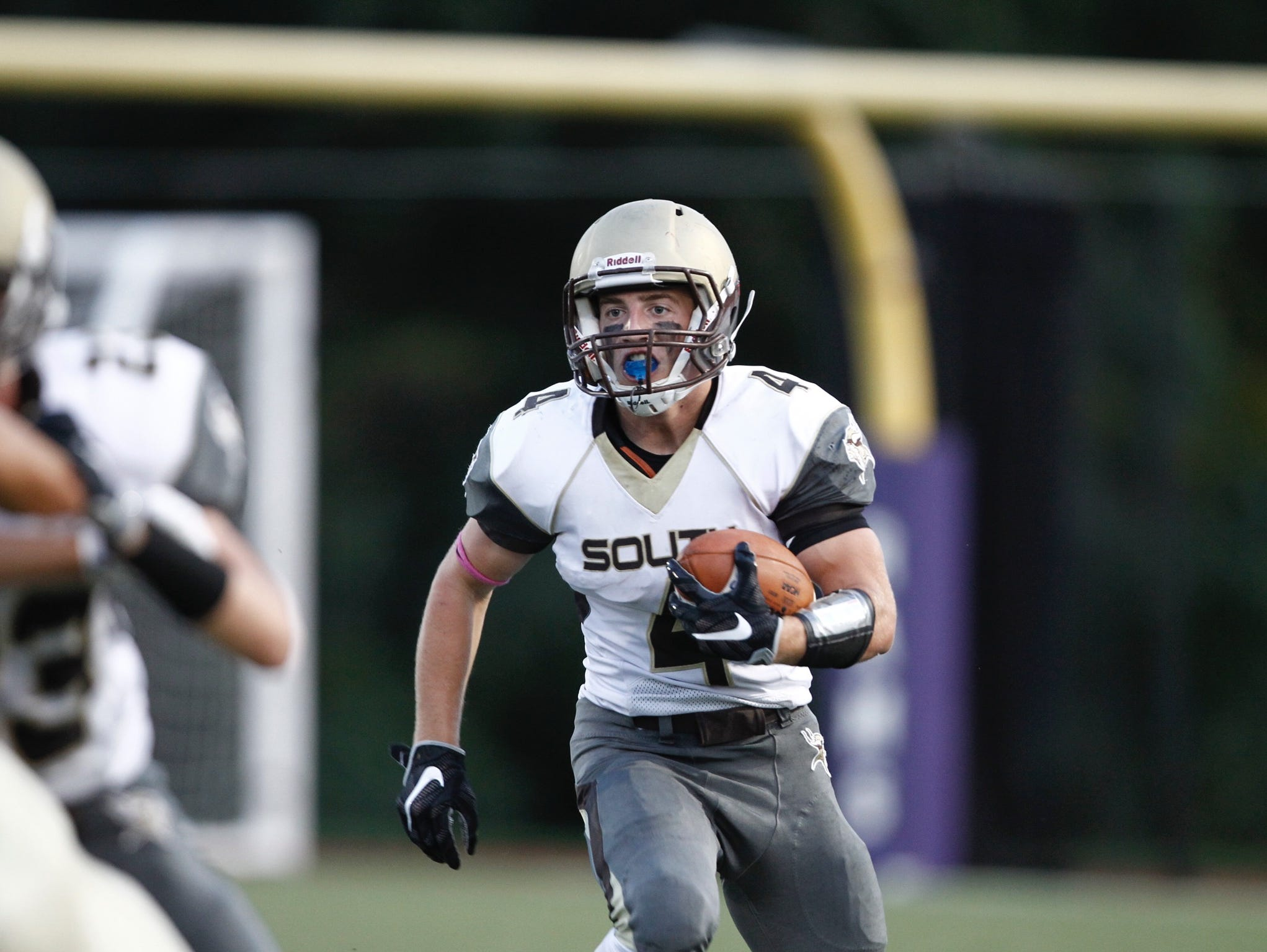Clarkstown South senior Kyle Samuels rushes the ball during a game at Clarkstown North. Sept. 2, 2016.