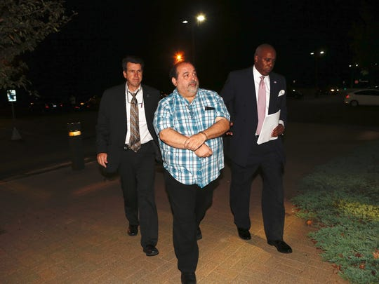 Ramapo building inspector Anthony Mallia is led into Ramapo Town Court after his arrest on Thursday, Sept. 15th, 2016.