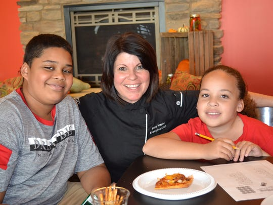 Chef Stacy Maple with Marcus and Maddy Shobe, two of the many kids who recently attended the weekly Snack and Study program at Bistro 163.