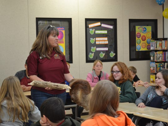 Deb Nofzinger shows students at McPherson Middle School