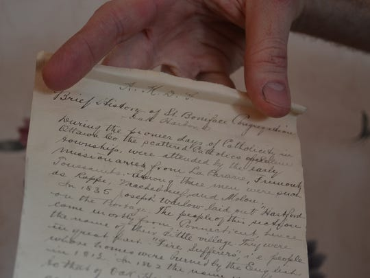 This handwritten scroll telling a brief history of Oak Harbor was one of many items discovered inside a century-old time capsule that was buried at St. Boniface Catholic Church in Oak Harbor. The time capsule was opened during an event celebrating the 100th anniversary of the church's construction.