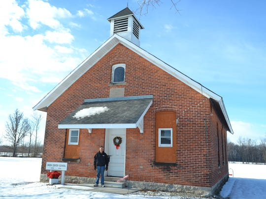 Norm Witt stands in front of Union Center School, the only intact one-room schoolhouse left in Ottawa County. Witt completed restorations on the school about five years ago.