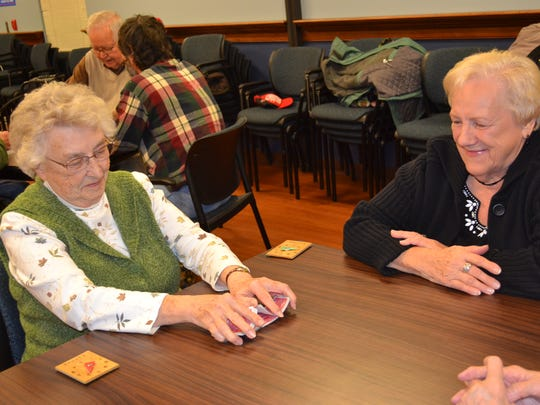 Ann Christmasa, left, and Barb Turner play Euchre at Ida Rupp Public Library.