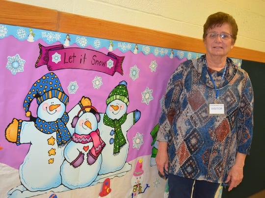 Barb Meyer has been volunteering at the school since the 1980s. One of her many duties is creating bulletin boards such as this one.