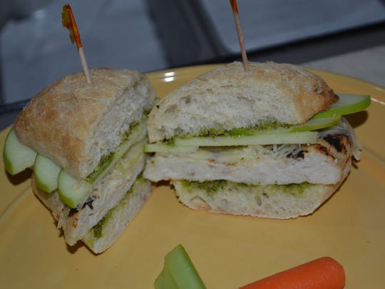 The Mrs. Crunchy sandwich is layered with chicken fillet, parmesan cheese, pesto and Granny Smith apple slices.
