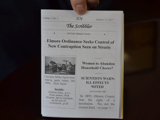 Patrick Lawrence O'Keeffe holds a copy of The Scribbler with its tongue-in-cheek headlines about the 19th century Elmore Bike.