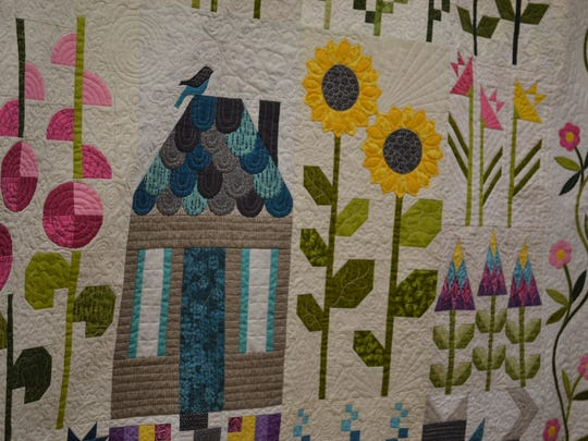"""Members of the Block of the Month club are working on this quilt, """"Quilter's Patch"""" by designer Edyta Sitar. Some of the club members work on their quilts at home, and some quilt at the shop during monthly 'Sit and Sew' events."""