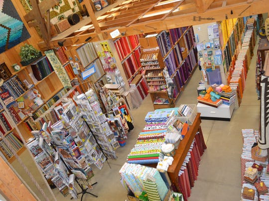 The Door Mouse quilt shop, housed inside a barn built in the early 1900s, is filled with bolts of fabric, quilting notions, books and patterns.
