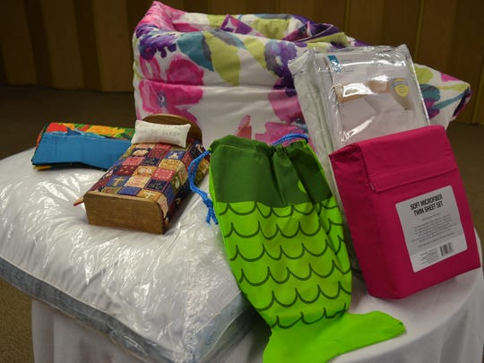 Children who receive a free, new bed through the 'Now I Lay Me Down To Sleep' ministry also get a mattress pad, sheets, blanket or comforter, pillow, pillowcase, book bag and two books.