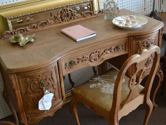 Unique offers art, handmade and vintage jewelry, new home décor and antiques, like this century-old English desk.