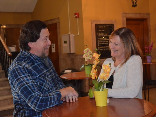 Christopher and Nancy Cullen talk at Pontifex, where Alpha classes are held. The neutral location creates a comfortable atmosphere for people who have questions about faith.