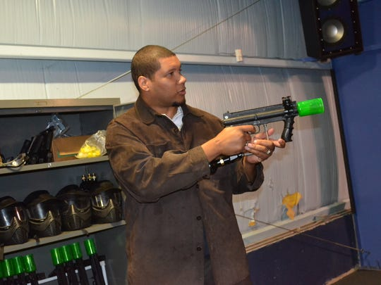 Robert Carter demonstrates Journey Ball, a mix of laser tag, paintball and Nerf.
