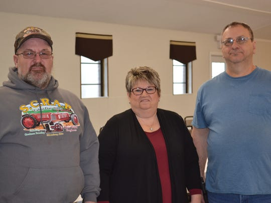Elwood Dick, left, and Gary Shearn, right, along with Elwood's brother, Roger Dick, recently remodeled their business, Memory Hall. Elwood's wife, Pam Dick,  center, helps promote the business.