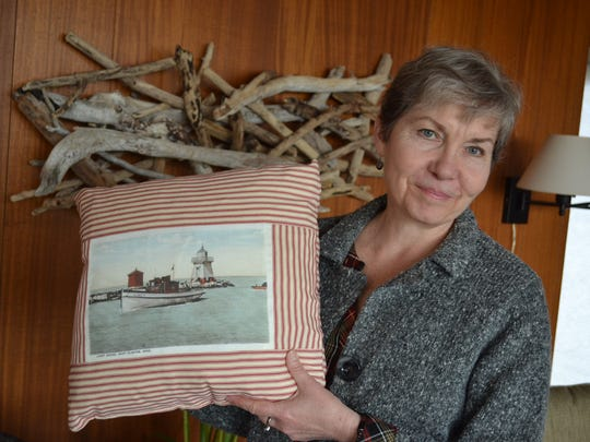 As a child, Sarah Thomas spent her summers at her family's Lakeside cottage, where her mother owned gift shops and her grandmother owned a candle shop. Today, she is continuing her family's entrepreneurial spirit by making throw pillows that give homage to the area's history.