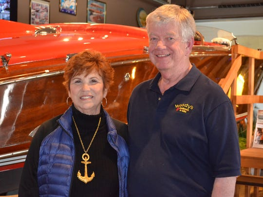 "Sherianne and Dennis Stacy built their store, Woody's Boathouse & Gifts, around the wooden speedboat ""Go Ballistic."""