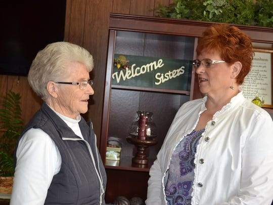 The Rev. Sheryl Seitz, right, talks with Edith Gray, who is organizing this year's Heritage Sunday service.