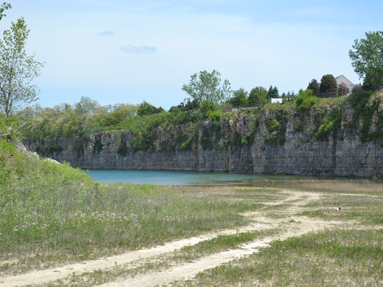The spring-fed quarry ebbs and flows from 4 to 70 acres